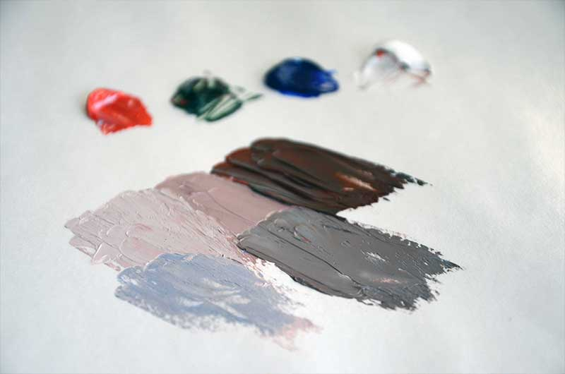 Photo of skin tones in oil paint mixed on painting pallet